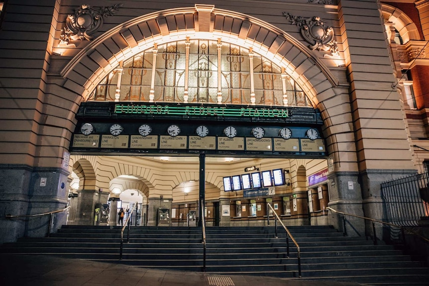 The entrance to Flinders Street Station is shown deserted at night.