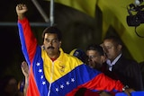 Venezuela's newly-elected president, Nicolas Maduro, gestures following the release of election results.