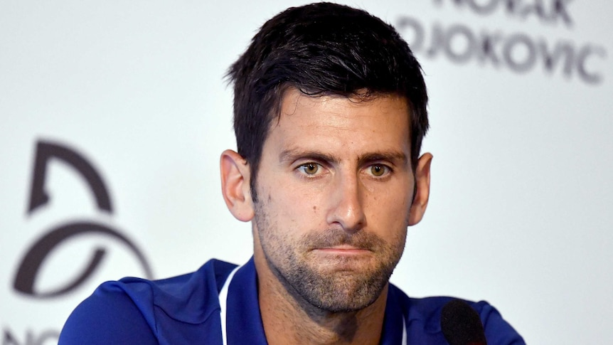 Novak Djokovic looks concerned at a press conference