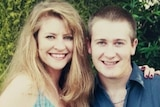 Missing woman Janine Vaughan and her brother Adam smiling at the camera with their arms around each other's shoulders