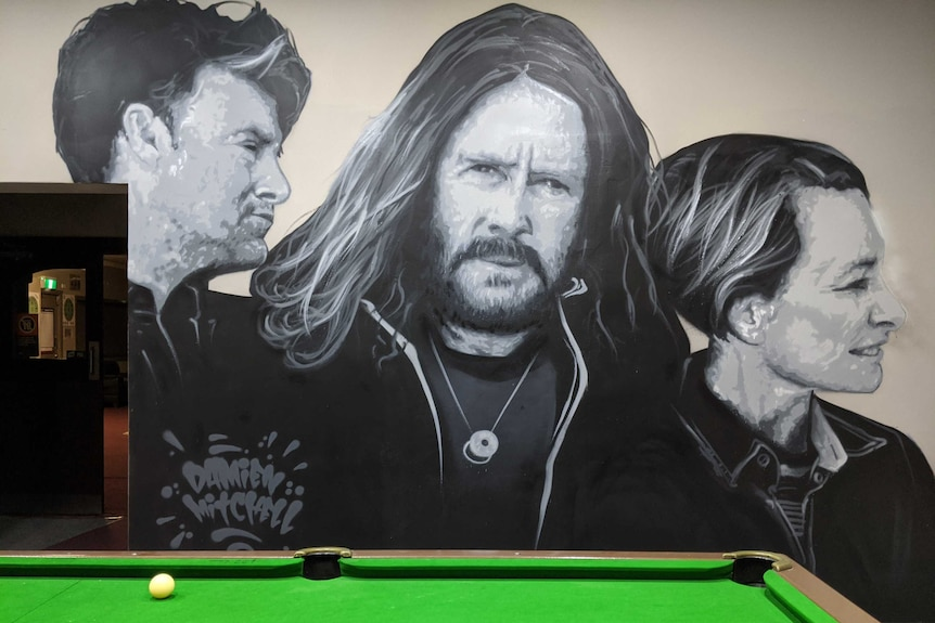 Mural of band Spiderbait painted on a pub wall in Finley