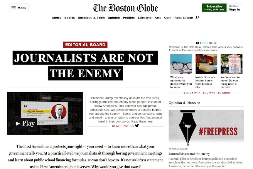 """A screenshot shows the Boston Globe newspaper's online homepage with a big headline reading """"Journalists are not the enemy""""."""