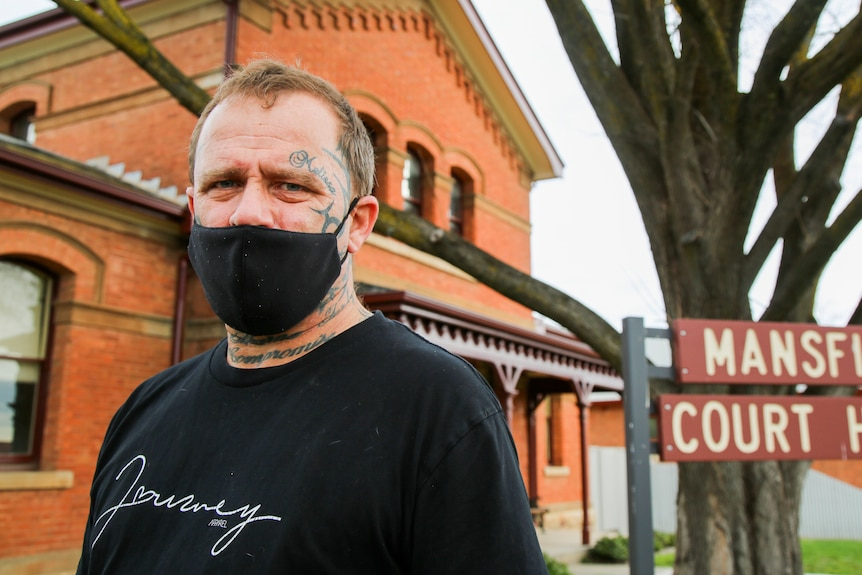 Brian Warton, wearing a black face mask, outside the Mansfield Court House.