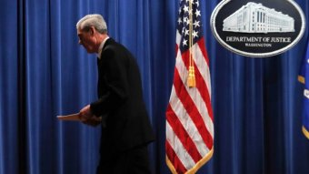 Special counsel Robert Muller walks from the podium