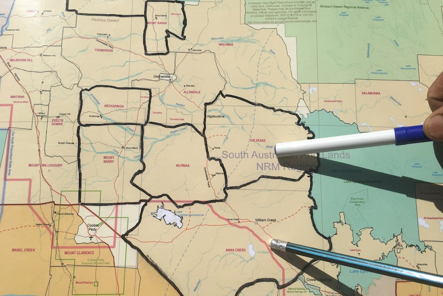 Pens pointing to a map showing the properties the Williams family will buy