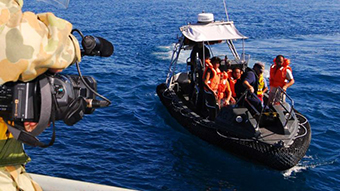 Defence personnel film asylum seekers