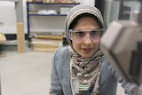 Fatemeh Javidan at work with safety glasses