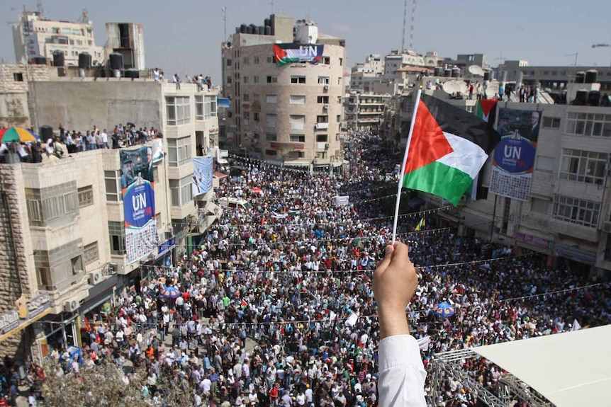 Palestinians attend a demonstration in Ramallah in support of the Palestinian bid for statehood. (AFP: Abbas Momani)