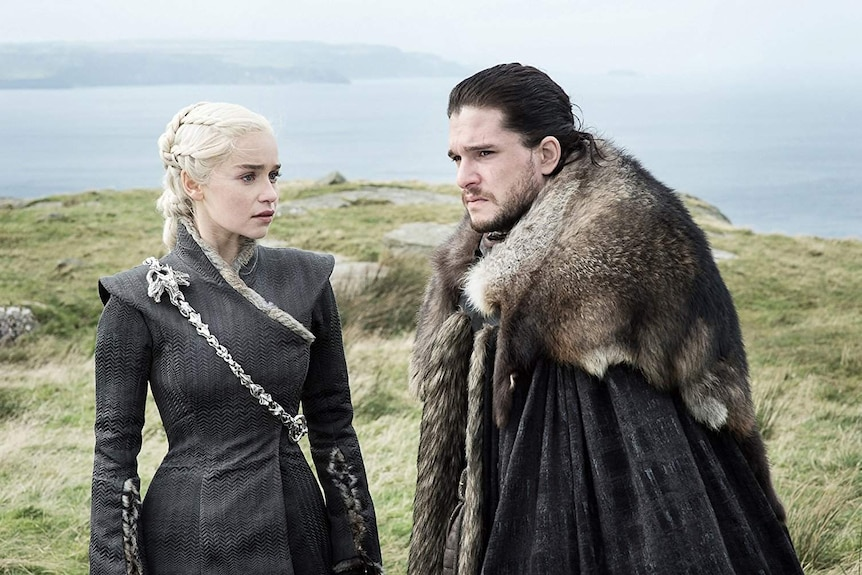 Screenshot of Jon Snow and Daenerys Targaryen on a cliff in the HBO TV series Game of Thrones.
