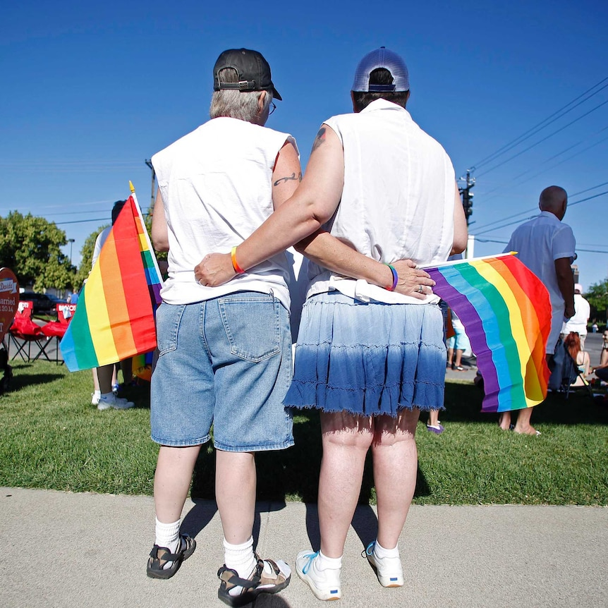 Gay couple at marriage ceremony