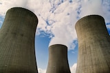 Steam rises from the stacks of a nuclear power plant