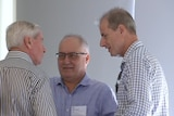 Alf Leonardi chats with former Chief Minister Paul Henderson at a conference.
