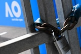 A silver padlock hangs around gates. The Australian Open logo is visible in the background
