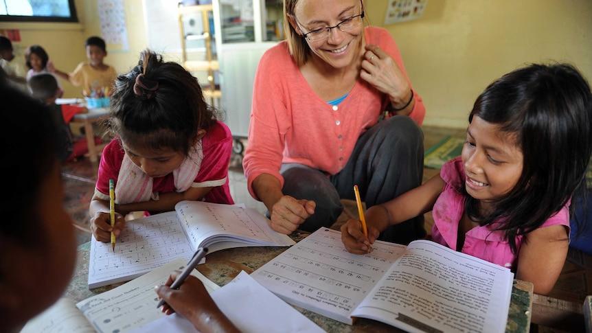 US volunteer teaching English to children in Cambodia