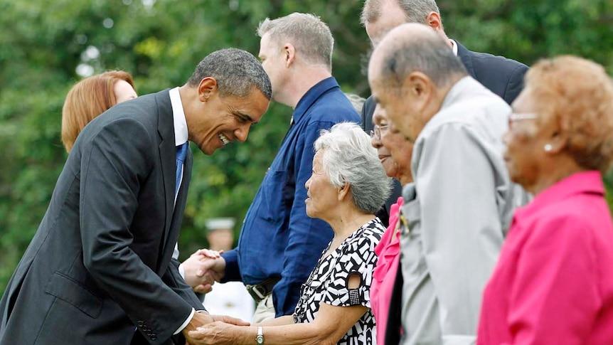 Barack Obama greets survivors of Japan's bombing of Darwin.