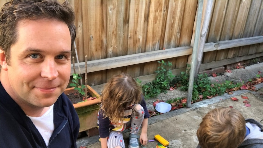 A selfie by Dr Hunter Mulcare shows him smiling with his two primary school-aged kids to depict homeschooling during coronavirus