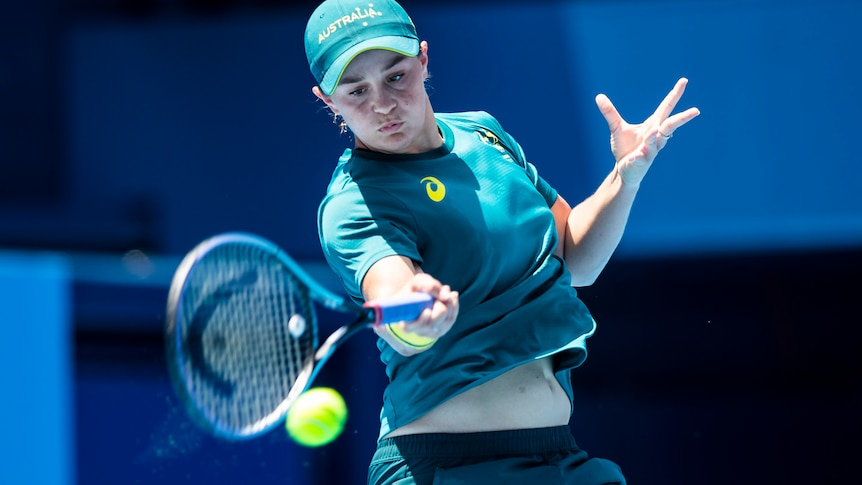 Tennis player hits a forehand.