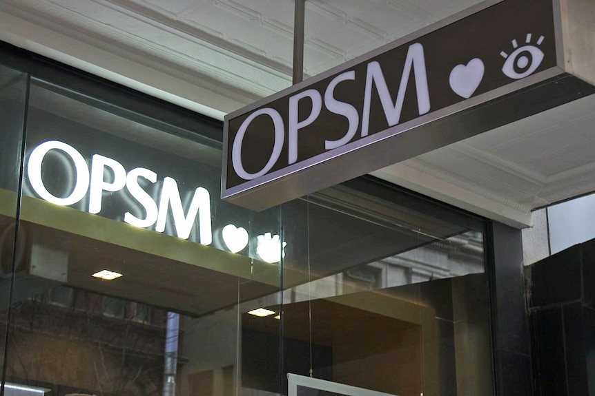 Store signs that say 'OPSM'.