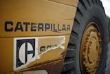 Caterpillar heavy equipment parked at a storage yard in Denver on July 22, 2008.