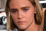 Australian swimmer Shayna Jack looks distressed amid a media pack.