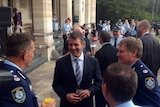 NSW Premier Mike Baird at his thank you morning tea for siege workers