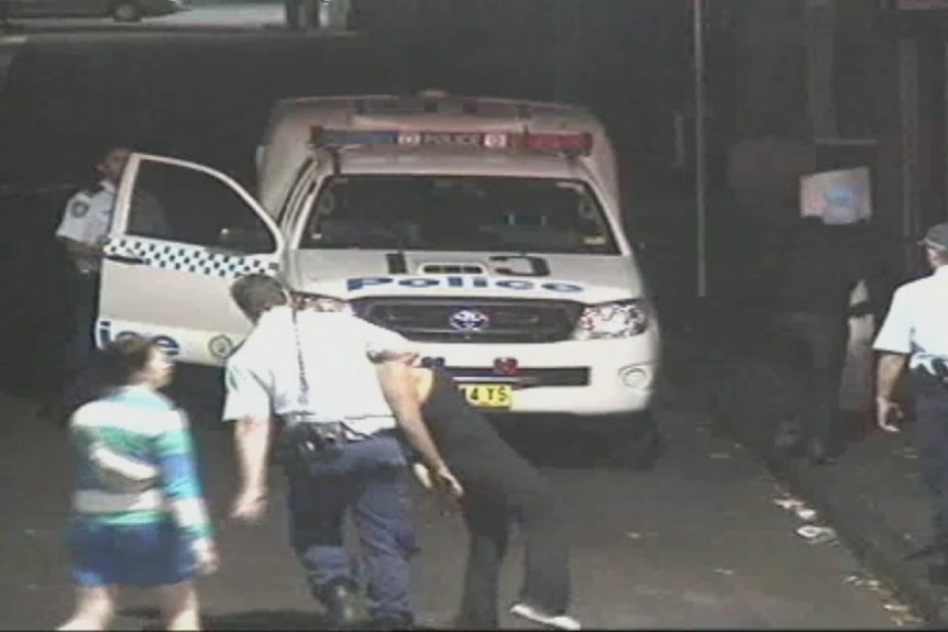 Melissa Dunn being dragged by police