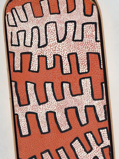 Ochre and cream dot with black out lines on oval shaped board from the early Papunya paintings of the 1970s