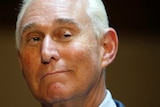 Roger Stone smiles at the camera.