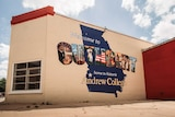 A mural on the side of a building reading 'welcome to Cuthbert'