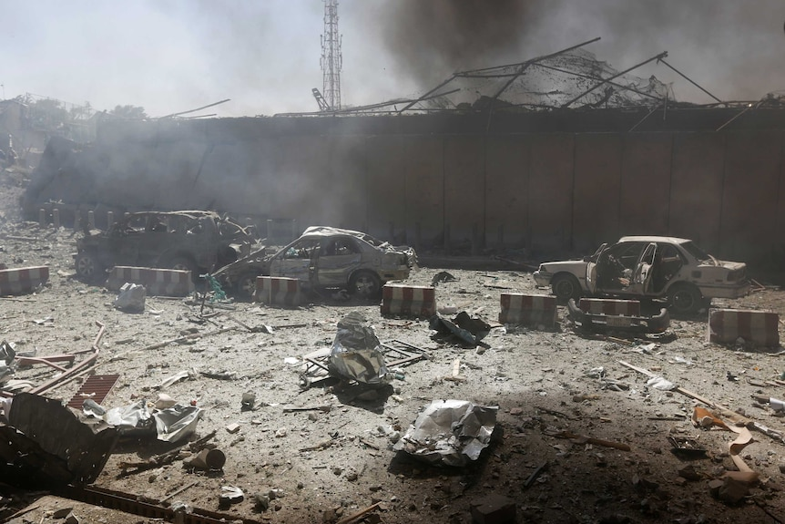 Damaged cars are seen after a blast at the site of the incident in Kabul, Afghanistan May 31, 2017.