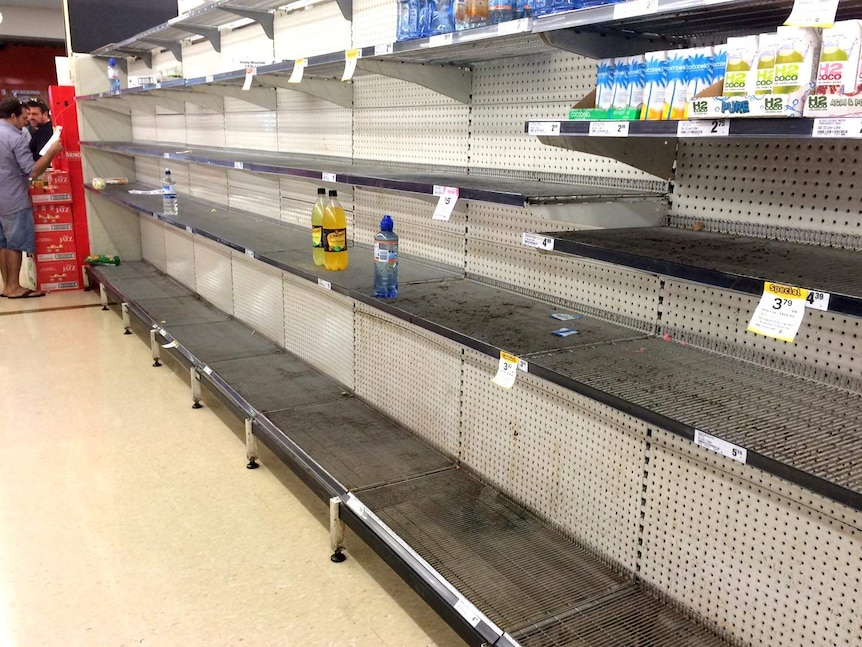 A few bottles remain on the shelves at Smithfield Woolworths ahead of the arrival of Cyclone Ita.