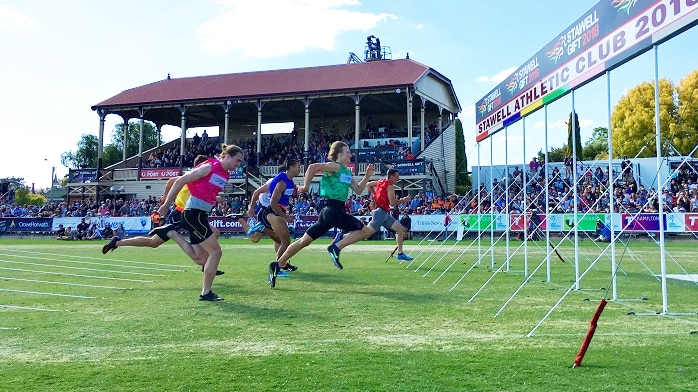Male runners cross the finish line in the Stawell Gift in Western Victoria