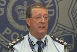 Queensland Police Commissioner Ian Stewart addresses the media