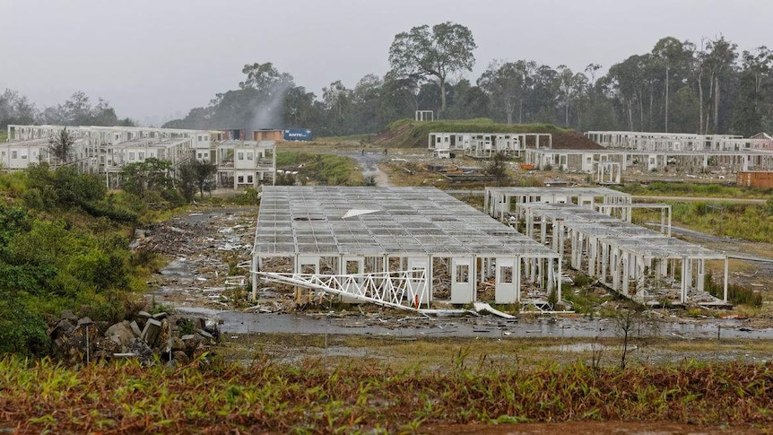 A series of workers lodgings in a jungle stripped completely bare.
