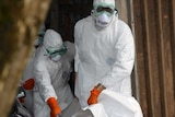 Red Cross workers in Monrovia carry body of Ebola victim