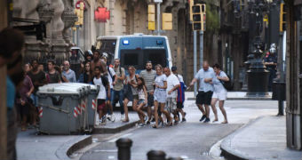 People flee from the historic Las Ramblas district of Barcelona.
