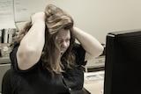 A woman yells at the computer