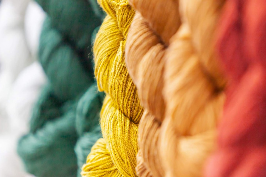 Yarn in twists in different colours including red yellow and green.