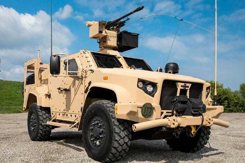 A large heavily armoured vehicle with a gun mounted on top.