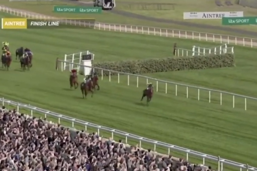 CGI horses run on a virtual race course with spectators in the foreground