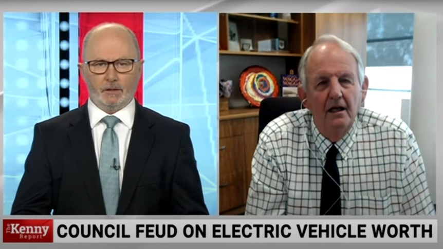 Screenshot of a splitscreen TV broadcast with bald man in suit on left and older man in shirt on right