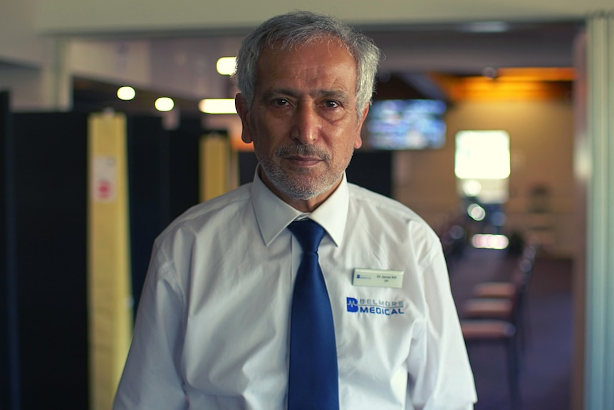 A portrait of a doctor who wears white business shirt and blue tie