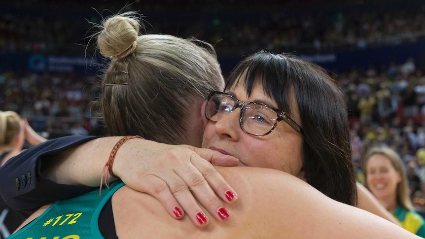 Australian netball coach Lisa Alexander hugs Courtney Bruce