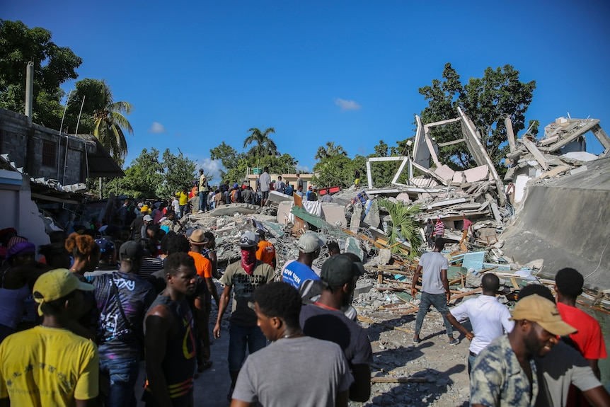 People search for survivors in rubble after homes were destroyed by the earthquake.