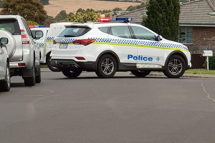Police cars in Bridgewater after a drive-by shooting.