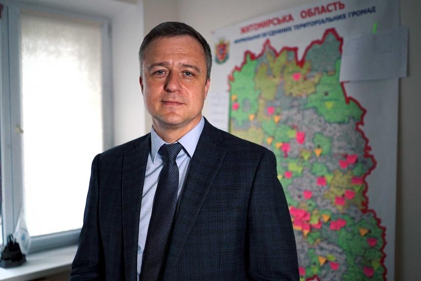 Children's Ombudsman, Nikolai Kuleba wearing a dark suit, stands looking toward the camera.