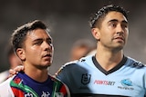 Cronulla Sharks player Shaun Johnson puts his arm around Warriors player Kodi Nikorima during an NRL game.