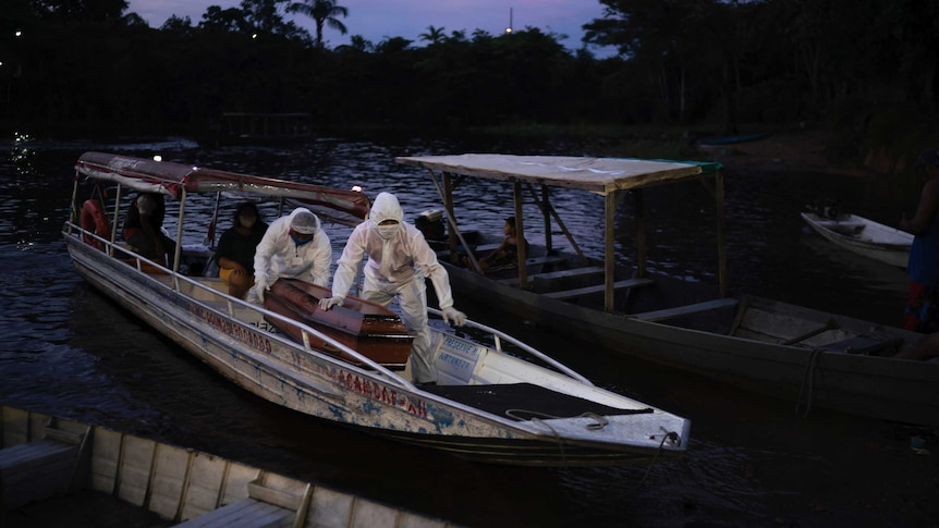 Funeral officials transport the bodies via boat in the Brazilian Amazon.
