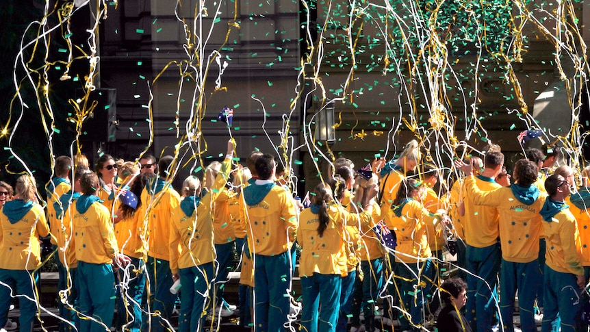 Streamers and confetti rain down on Australia's Olympic team in Sydney parade