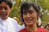 Burmese opposition leader Aung San Suu Kyi smiles as she leaves a polling station.